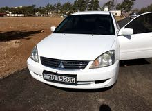 For sale Mitsubishi Lancer car in Al Karak