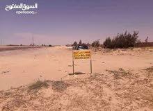 فرصة مخطط اراضي 100متر يبعد من يمين طريق بنغازي