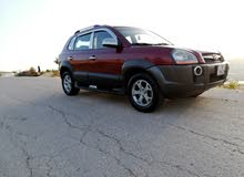 Maroon Hyundai Tucson 2009 for sale
