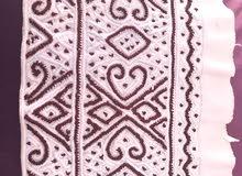 كمة عمانية خياطة العقدة