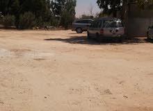 قطعة أرض على شارعين في مخطط سكني بمنطقة بوفاخره بعد