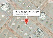 مربع 13 ارض سكنيه للبيع في العامرات مدينة النهضه موقع ممتاز ثاني قطعه من شارع