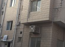 flat for rent at Muharraq with 2 bedrooms, hall , 2 bathrooms and kitchen