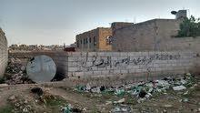 ارض حر مكونه من اربع لبن  الواجهه 11متر حزيز بجوار سوق الوحده