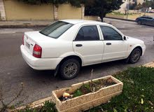 +200,000 km mileage Mazda 323 for sale