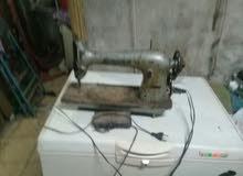 ماكينة خياطه ماركة سنجر مع امكانية التشغيل الكهربي