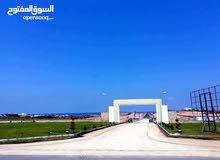 قطعة ارض على البحر في غنيمة بجانب منتجع غنيمه السياحي
