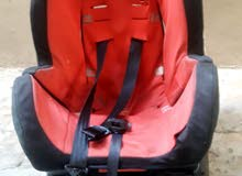 Used red/black car seat