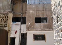 عمارة في اربد شارع فلسطين مقابل البنك العربي