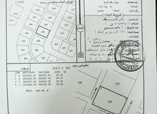 أرض سكنية كورنر  للبيع في العويد جنوب بالقرب من منازل قائمة
