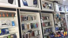محل هواتف في سوق السيب بكامل معداته للبيع