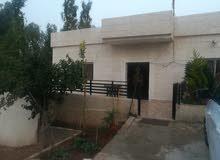 بيت مستقل على دونم في مكان ريفي مميز قريب من اوتوستراد اربد عمان وجرش من المالك