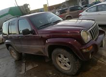 Maroon Jeep Liberty 2004 for sale