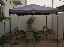 pergola and table of 6 chairs