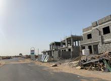 فلل سكنية للبيع بالتقسيط فى عجمان-الزاهية-معفي الرسوم-كل الخدمات-شوارع قار وأعمدة إنارة