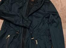 معطف مطر Defacto hooded raincoat لون أخضر