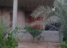 منزل من طابقين مظلة وشقة على ارض 400 متر بدير البلح