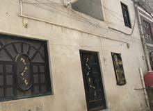 بيت للبيع في الحيانية الطاك شارع مركز الفراهيدي قريب على سوك المدينة بلفرع