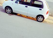 نوع سيارة كيوكيو لاتوت 2012 في حال جيدة تمشي 100%
