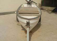 قارب 12 قدم مع مكينه 15 حصان مع العربه ب450 ريال