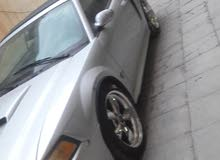 Automatic Grey Ford 2000 for sale