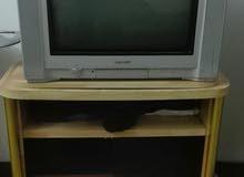 تلفزيون شارب مع طاوله 25 دينار