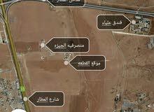 ارض 600م بجانب مبنى المتصرفيه طريق المطار منطقه فلل