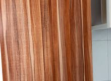 طاولة خشبية بقواعد حديدية Wooden table with iron bases