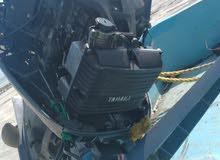 قارب 23مع محرك115