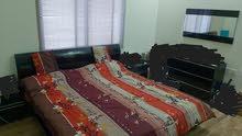 bedroom with 4 door cabinet