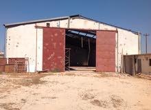 الكيخيا للعقارات بنغازي  قطعة أرض هكتار زراعية بموقع بنينا بجانب البوابة الالكترونية
