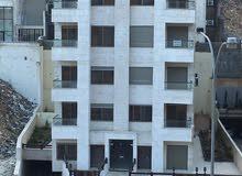 شقة ارضية مميزة مساحة 100 متر مع حديقة وكراج مستقل 150 متر باجمل مواقع عبدون