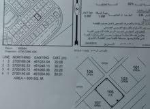 بناية على شارع مطار صحار للبيع