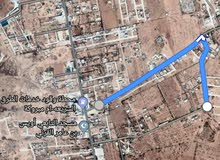 قطعتين أرض في أم مبروكة شارع مقابل محطة وقود خدمات طرق السريعه