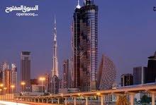 تملك في قلب دبي الجديد مع اطلالة على اعلى برجين بالعالم برج خليفة و برج دبي الجديد في الخور