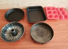 مجموعة أواني للطهي بالفرن ، set of utensils used inside oven