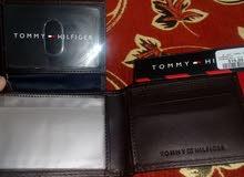 محفظة نوع تومي هيلفيغر جديدة صناعة هندية كيف واصلة من كندا