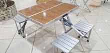طاولة قابلة للطي مع 4 كراسي جميلة