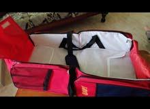 سرير متنقل و حقيبة رحلات مع الطفل