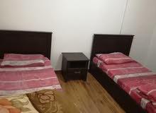 شقة طابق أرضي مفروشة للايجار قرب مركز الحسين