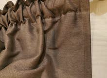 Brownish grey curtains with free holder stick