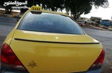 نيسان صني للبيع تكسي اصفر عمان