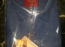 قميص جينز جديد مستورد نص كم مقاس 5XL لون أزرق كحلي فاتح السعر 276 جنيه