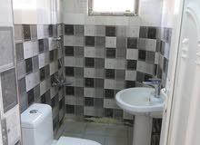 للايجار شقة ارضية معزولة في الكرادة خارج ب700 الف
