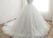 فستان عروس جديد (مو ملبوس) لون ابيض والقياس 38
