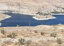 قطع أراضي ذات أطلاله خلابه على سد الملك طلال