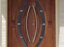 أبواب مصنوعة من خشب التيك و المهوجني الطبيعي
