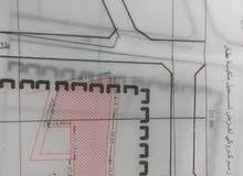 ارض مساحة1975متر تجارية او سكنية