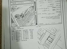 سكني تجاري الطريف جنب الأرض عدة مباني محلات وشقق