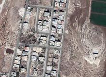 ارض للبيع طريق المطار خلف مدرسه الشويفات مباشره و نادي الجواد العربي